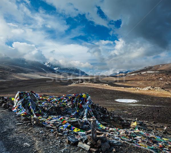 Buddhist prayer flags (lungta) on Baralacha La pass in Himalayas Stock photo © dmitry_rukhlenko