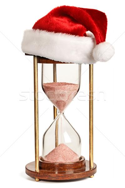 Navidad reloj de arena papá noel sombrero aislado blanco Foto stock © dmitry_rukhlenko