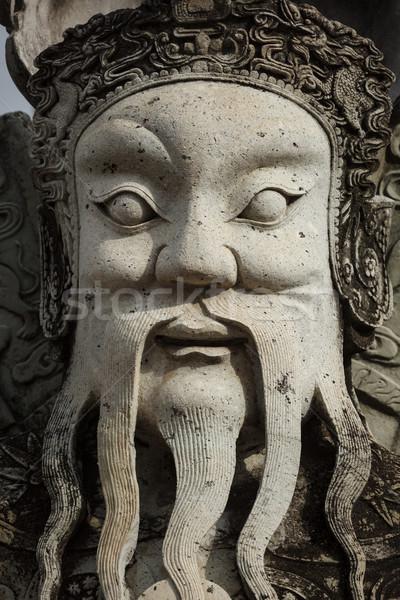 Wat Pho stone guardian face close up, Thailand Stock photo © dmitry_rukhlenko