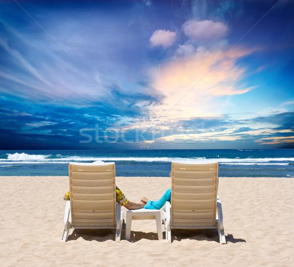 Honeymoon couple enjoy ocean sunset Stock photo © dmitry_rukhlenko