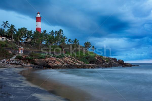 Gathering storm on beach and lighthouse on sunset. Kerala, India Stock photo © dmitry_rukhlenko