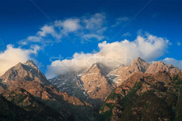 Himalayas summits in clouds on sunset Stock photo © dmitry_rukhlenko