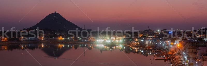 Panorama sagrado lago ciudad crepúsculo Foto stock © dmitry_rukhlenko