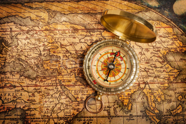 Old vintage golden compass on ancient map Stock photo © dmitry_rukhlenko