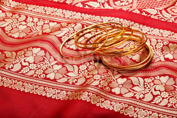 Indian sari with golden bangles Stock photo © dmitry_rukhlenko