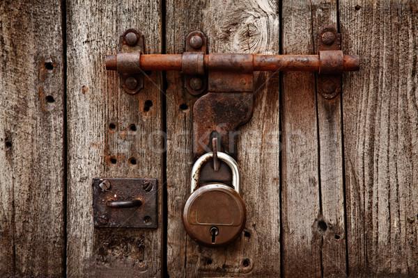 Latch with padlock on gatees Stock photo © dmitry_rukhlenko