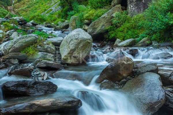 Cascade falls over mossy rocks Stock photo © dmitry_rukhlenko
