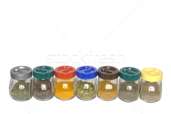 Jars with various spices (fenugreek,allspice tree, turmeric, car Stock photo © dmitry_rukhlenko