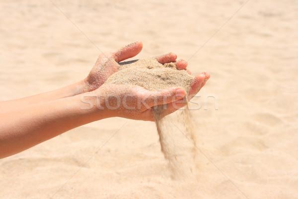 Sand running through hands Stock photo © dmitry_rukhlenko