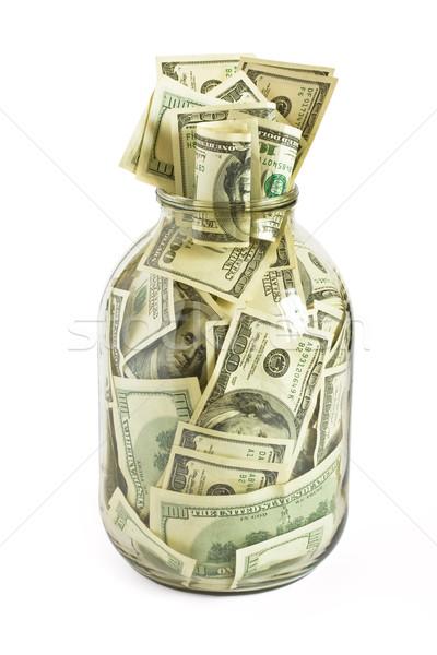Hundreds of dollars stuffed in a glass jar Stock photo © dmitry_rukhlenko