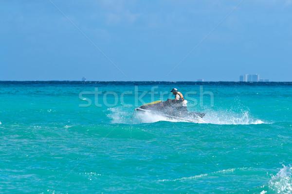 Férfi lovaglás jet ski Karib tenger víz Stock fotó © dmitry_rukhlenko