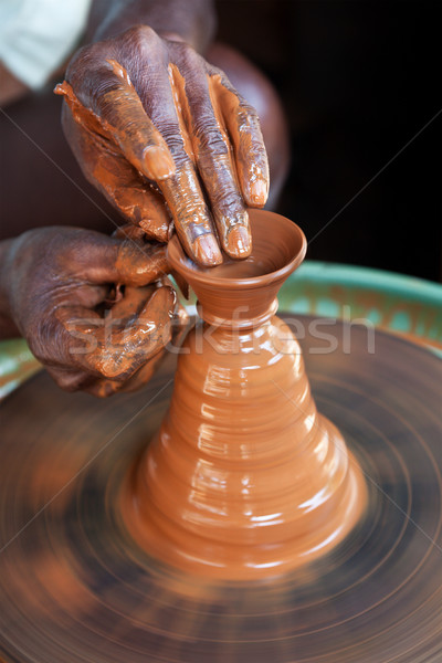 Potter throwing  Stock photo © dmitry_rukhlenko