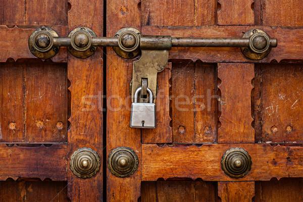 Latch with padlock on door  Stock photo © dmitry_rukhlenko