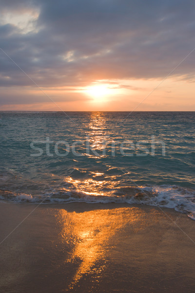 Stock photo: Calm ocean and beach on tropical sunrise