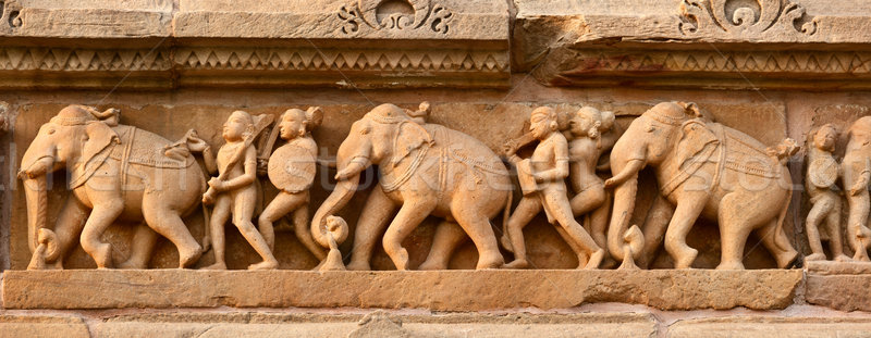 Stone carving bas relief panorama, Lakshmana Temple, Khajuraho,  Stock photo © dmitry_rukhlenko