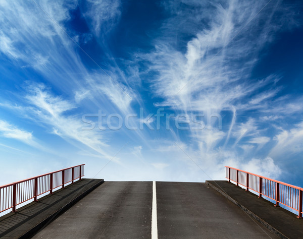 Asphalt road going into sky with clouds Stock photo © dmitry_rukhlenko