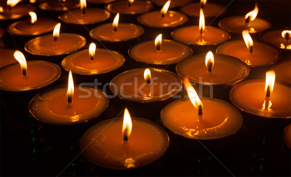 Burning candles in Tibetan Buddhist temple Stock photo © dmitry_rukhlenko