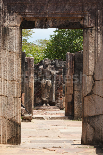 Passage in ruins to Buddha statue. Pollonaruwa, Sri Lanka Stock photo © dmitry_rukhlenko