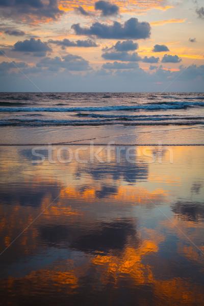 Zonsondergang strand goa Indië hemel oceaan Stockfoto © dmitry_rukhlenko