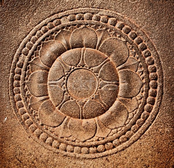 Stylized lotus carved on stone Stock photo © dmitry_rukhlenko