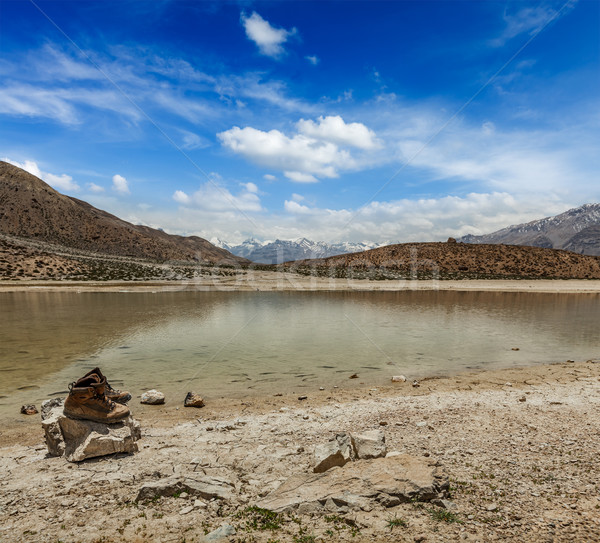 Trekking hiking boots at mountain lake in Himalayas Stock photo © dmitry_rukhlenko