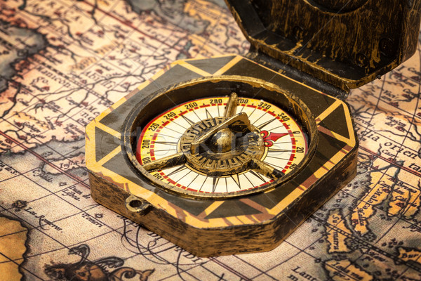 Vintage pirate compass on ancient map Stock photo © dmitry_rukhlenko