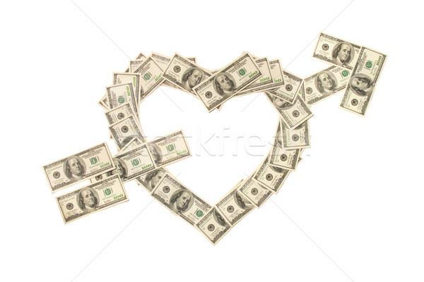 Heart pierced with arrow made of hundred dollar banknotes isolat Stock photo © dmitry_rukhlenko