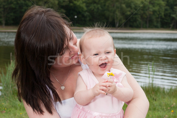 Mother baby and the flower Stock photo © DNF-Style