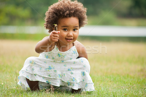 African girl with a flower Stock photo © DNF-Style