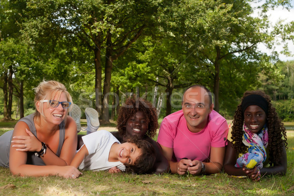 Stock photo: Ethnic family on the grass