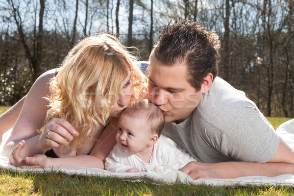 Young parents are kissing the baby Stock photo © DNF-Style