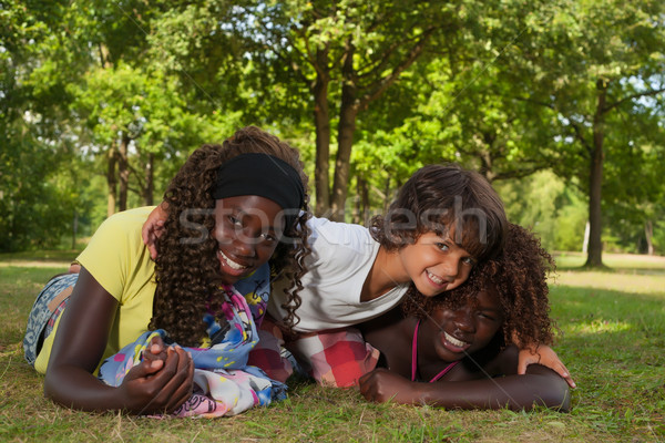 Little boy and his adoption sisters Stock photo © DNF-Style