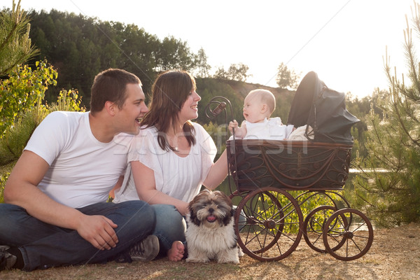 Happy family with vintage pram Stock photo © DNF-Style
