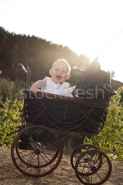 Boldog lány babakocsi kislány ül klasszikus mosoly Stock fotó © DNF-Style
