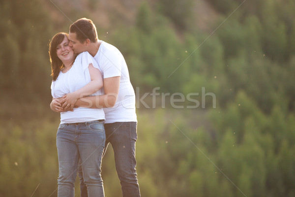 Young woman gets a kiss from her man Stock photo © DNF-Style