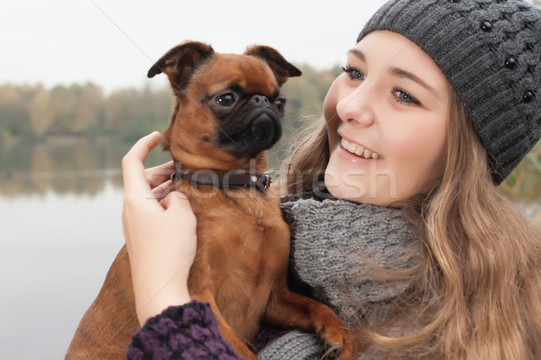 Sweet winter teenager and her dog Stock photo © DNF-Style