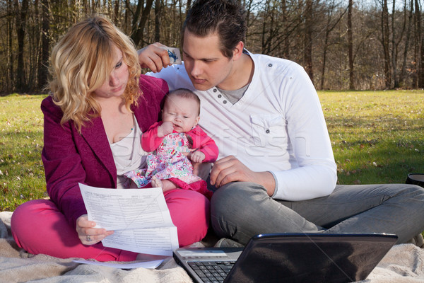 Stock photo: Young family busy with financials