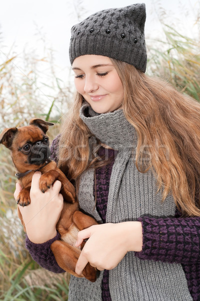 Sweet winter teenager and her little dog Stock photo © DNF-Style