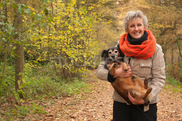 Middle aged woman is carry the dog Stock photo © DNF-Style