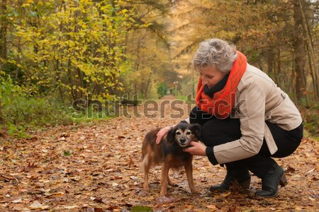 Ager woman and her dog Stock photo © DNF-Style