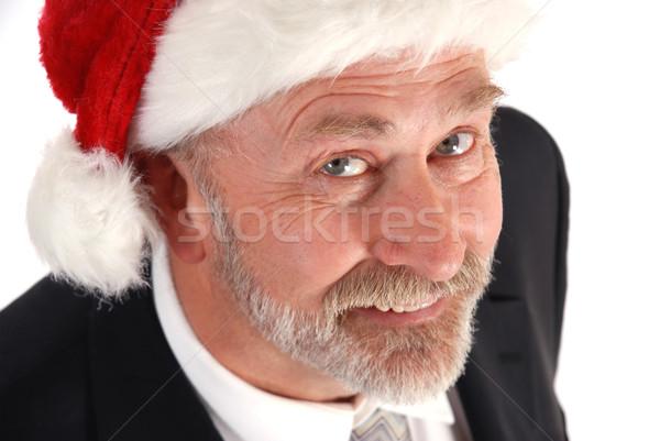 üzletember karácsony idős visel mikulás kalap Stock fotó © dnsphotography