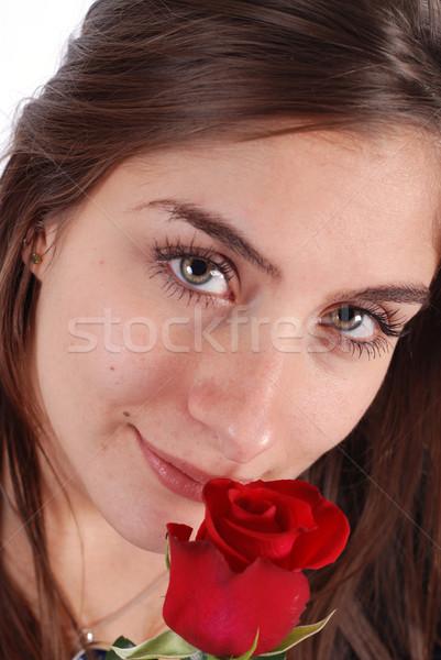 Fiatal lány rózsa fiatal nő piros virág nő Stock fotó © dnsphotography