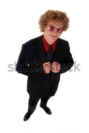 Işadamı genç ayakta siyah takım elbise beyaz arka plan Stok fotoğraf © dnsphotography