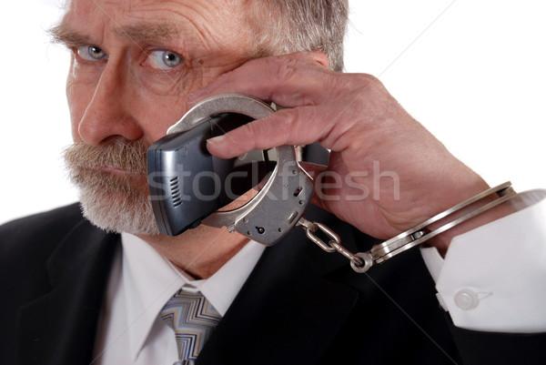 Telefon üzletember megbilincselve mobiltelefon férfi öltöny Stock fotó © dnsphotography