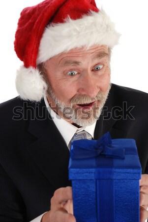 Işadamı Noel kıdemli hediye noel baba şapka Stok fotoğraf © dnsphotography