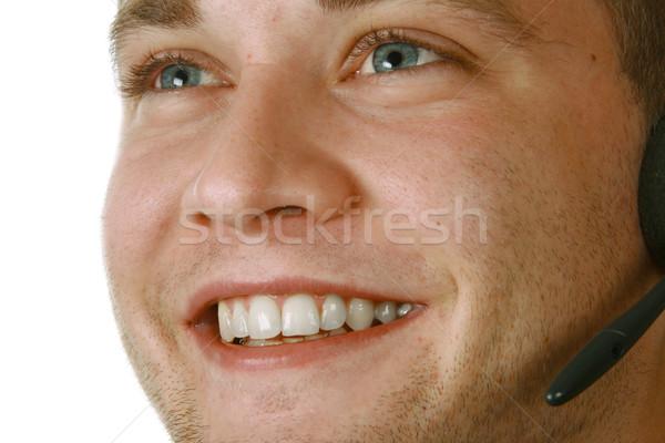 Mosolyog férfi headset fiatal üzletember visel Stock fotó © dnsphotography
