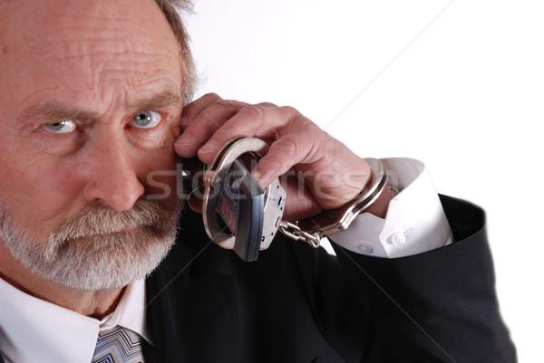 Mobiele telefoon zakenman handboeien mobiele telefoon telefoon man Stockfoto © dnsphotography