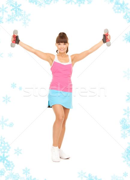 Fitness instruktor hantle biały kobieta śniegu Zdjęcia stock © dolgachov