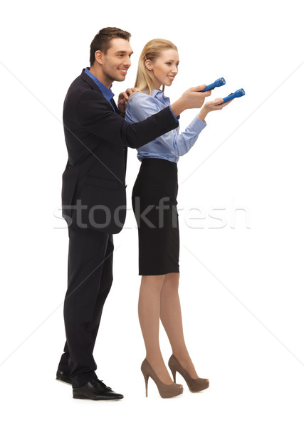 man and woman with flashlights Stock photo © dolgachov