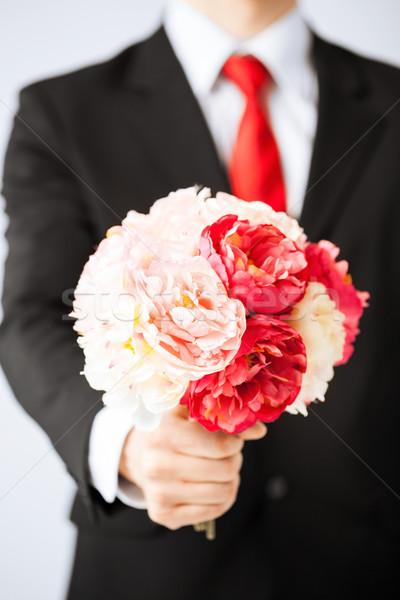 Férfi virágcsokor virágok közelkép fiatalember esküvő Stock fotó © dolgachov